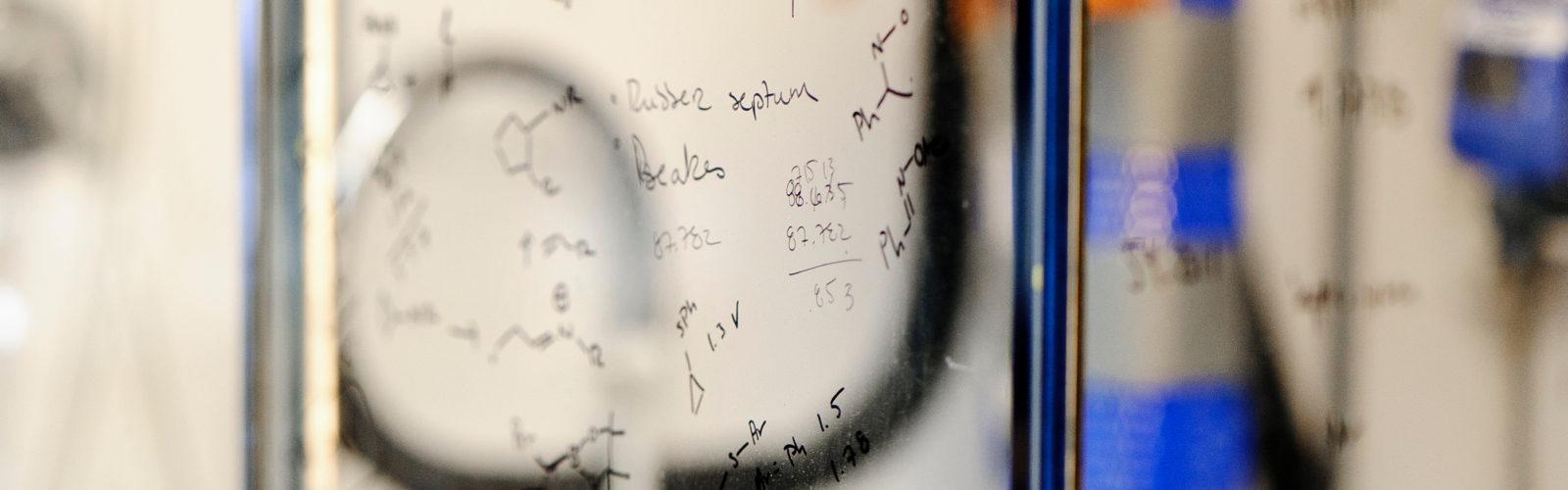 Writing on the glass sash of a chemical fume hood